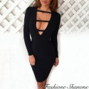 Slinky black dress with plunging neckline